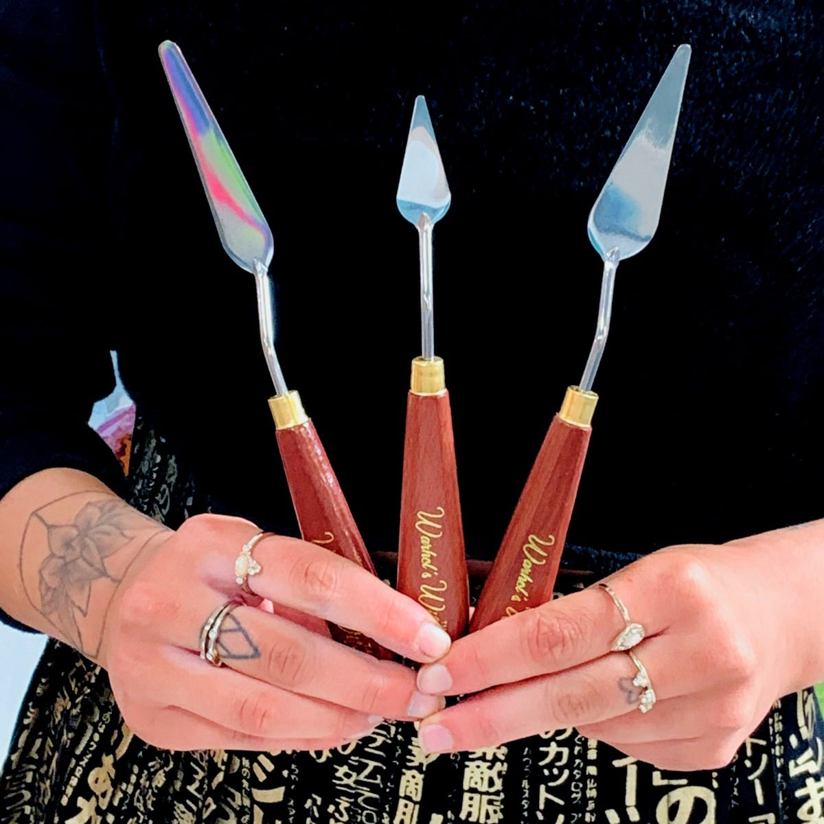 Warhol's Wife Palette Knives being held by Artist